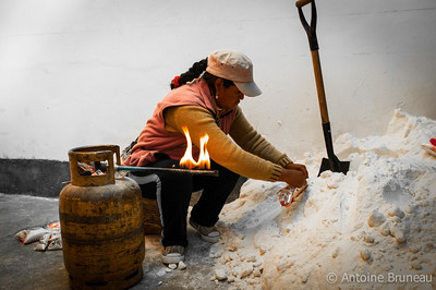 Colchani, Bolivia. There is an estimated 10 billion tonnes of salt contained in the Salar de Uyuni. Around 25,000 tonnes of it is excavated and processed annually in Colchani, a tiny one street village situated on the edge of the Salar de Uyuni.